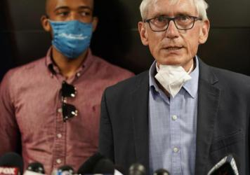 Wisconsin Gov. Tony Evers announced the National Guard would be deployed in anticipation of another round of unrest in Kenosha. Evers is seen during a press conference in August.