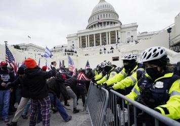 Trump supporters try to break through a police barrier at the Capitol in Washington, D.C., on Wednesday. As Congress prepares to affirm President-elect Joe Biden's victory, thousands of people have gathered to show their support for President Trump.