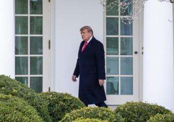 WASHINGTON, DC - DECEMBER 31: U.S. President Donald Trump walks to the Oval Office while arriving back at the White House on December 31, 2020 in Washington, DC.