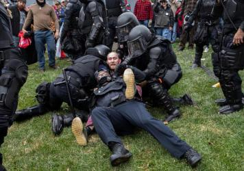 A pro-Trump protester resists arrest on Wednesday. There were few arrests in relation to the scope of the unrest as of Wednesday night.