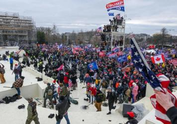 Pro-Trump extremists clash with police and security forces as they invade the Inauguration Day platform on Wednesday. Security forces were quickly overrun as the mob reached the Capitol.