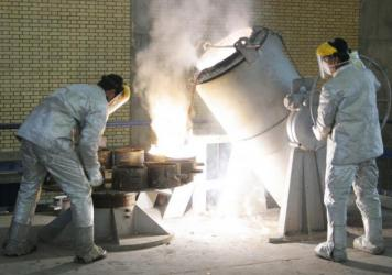 Technicians work inside of a uranium conversion facility producing unit in 2005 outside the city of Isfahan, Iran. After the 2015 Iran nuclear deal put limits on the program, Iran's government has been increasing uranium enrichment since the United State