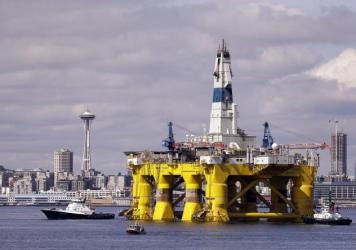 The drilling rig Polar Pioneer outfitting for arctic oil exploration in 2015. A proposed rule from the Trump administration would force banks to offer financing to oil companies, gun-makers, and high-cost payday lenders, even if the banks don't want to d