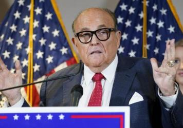 "The New York State Bar Association is launching a ""historic"" inquiry into Trump attorney Rudy Giuliani, shown here at a November press conference in Washington, D.C."