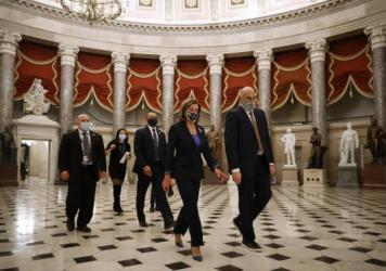 House Speaker Nancy Pelosi, D-Calif., heads to the House Chamber at the U.S. Capitol Tuesday. The House is debating whether to impeach President Trump a second time on Wednesday.