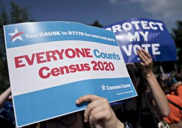 A demonstrator holds a sign about the U.S. census outside the Supreme Court in Washington, D.C., in 2019. The Census Bureau has stopped all work on President Trump's directive to produce a count of unauthorized immigrants that could be subtracted from a