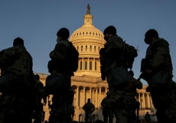 Members of the National Guard gather outside the U.S. Capitol — part of a massive boost to security after the riot last Wednesday, and leading up to Inauguration Day.