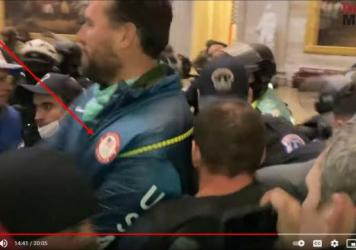 A screenshot from the Jan. 6 U.S. Capitol insurrection allegedly shows gold medalist swimmer Klete Keller wearing an Olympic jacket.