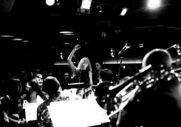 Maria Schneider (center) whose album <em>Data Lords</em> was one of 2020's most acclaimed jazz albums, performs with her orchestra at the New York City club Jazz Standard, where the group had an 16-year annual Thanksgiving week performance that was inter