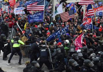 Pro-Trump supporters breeched security and stormed the U.S. Capitol on Jan. 6, 2021. Federal authorities as well as several local departments are looking into whether any off-duty officers were involved in the attack.