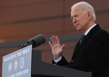 """One day before being inaugurated as the 46th president of the United States, President-elect Joe Biden delivers remarks Tuesday at the Maj. Joseph R. """"Beau"""" Biden III National Guard/Reserve Center in New Castle, Del."""