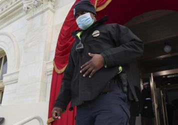 U.S. Capitol Police Officer Eugene Goodman attends a dress rehearsal for the 59th inaugural ceremony for President-elect Joe Biden and Vice President-elect Kamala Harris at the Capitol on Monday.