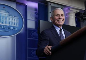 """Dr. Anthony Fauci laughs while speaking at a White House briefing on Thursday. Fauci, President Biden's chief medical adviser on COVID-19, says he rejoiced when the new president declared that """"science and truth"""" would guide the nation's policies toward"""