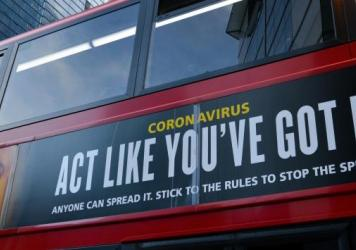 "Moderna will test new COVID-19 vaccine boosters, saying that while its vaccine should protect against variants found in the U.K. and South Africa, it isn't as effective against one strain.  Here, a bus in London carries a sign telling people, ""Act Like Y"