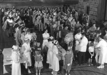 Residents of Protection, Kan., gathered in the high school gym to receive polio shots on April 2, 1957. The mass inoculation event was staged by the March of Dimes, then known as the National Foundation for Infantile Paralysis.