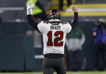 Tampa Bay Buccaneers quarterback Tom Brady reacts after winning the NFC championship against the Green Bay Packers in Green Bay, Wis., on Sunday. The Buccaneers will meet AFC champions Kansas City Chiefs Feb. 7 in Super Bowl LV.