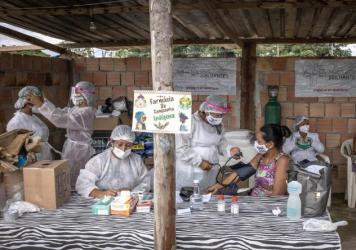 Indigenous health care workers treat patients last week at a campaign hospital set up in the Parque das Tribos neighborhood of Manaus, Brazil. Oxygen shortages at hospitals in Brazil's Amazon prompted authorities to airlift patients to other states.