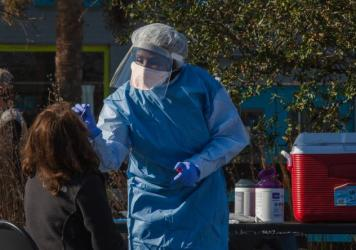 A health care worker from the Medical University of South Carolina administers a coronavirus test this month in Charleston, S.C. U.S. health authorities said Thursday that the first U.S. cases of the variant that emerged from South Africa were detected i