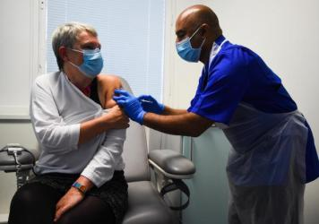 Nurse Vash Deelchand inoculated Kate Bingham, chair of the U.K. government's vaccine task force, with a Novavax vaccine at the Royal Free Hospital in London in October.