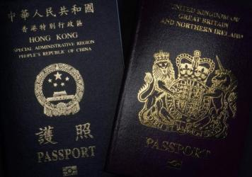A British National Overseas passport (right) and China's Hong Kong Special Administrative Region passport. China said Friday it will no longer recognize the BNO passport as a valid travel document or form of identification.