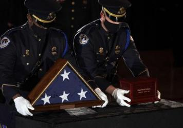 Sicknick's remains are placed next to a U.S. flag on a pedestal in the Capitol Rotunda Tuesday evening.