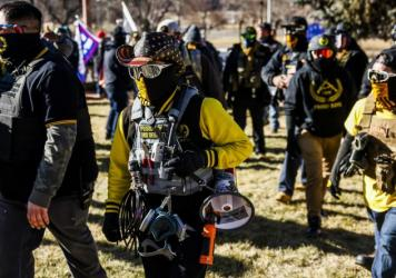 """Public Safety Canada notes that last month, members of the Proud Boys """"played a pivotal role in the insurrection at the U.S. Capitol."""" Here, Proud Boys members join Donald Trump supporters at a protest outside the Colorado State Capitol last month in Den"""