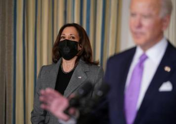 Vice President Harris listens as President Biden speaks on racial equity before signing executive orders at the White House on Jan. 26, part of a largely traditional public role she has played since taking office two weeks ago.
