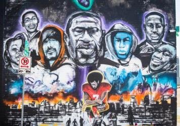 A mural honoring George Floyd and the larger Black Lives Matter movement is pictured on a wall of Native Hostel. It was created by local artist Chris Rogers.