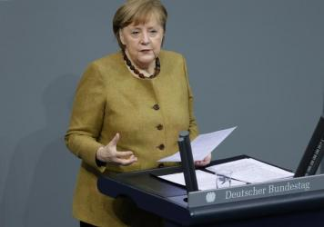 German Chancellor Angela Merkel addresses the Bundestag in Berlin on the German government's measures against COVID-19 on Thursday.