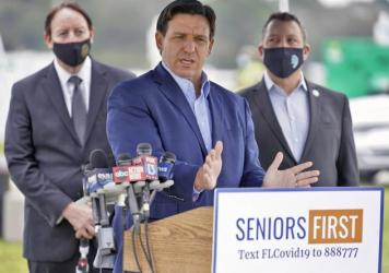 Florida Gov. Ron DeSantis speaks to the media at a COVID-19 vaccination site near the upscale Lakewood Ranch community in Bradenton, Fla., on Wednesday.