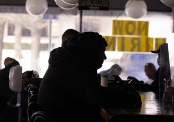 Patrons sit in a restaurant without power caused by cold weather blackouts on Tuesday in Richardson, Texas.