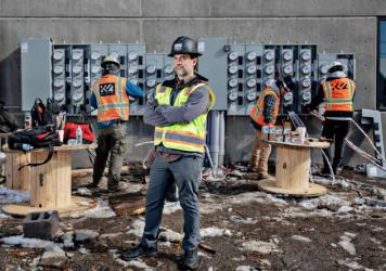 """Tyler Hollon, who works for a construction company in Utah, says eliminating natural gas from apartment buildings can reduce costs. Hollon's company now shares its designs and budgets with other builders. """"The reason we're giving it away is to clean up t"""