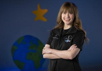 A photo provided by St. Jude Children's Research Hospital shows Hayley Arceneaux at the hospital in Memphis, Tenn. It announced on Monday that Arceneaux, a former patient and current employee, will be one of four crew members on the first all-civilian sp
