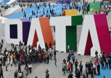 "Visitors walk past the giant word ""Data"" during the Guiyang International Big Data Expo 2016 in southwestern China. China says it's determined to be a leader in using artificial intelligence to sort through big data. U.S. officials say the Chinese effort"
