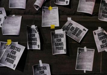 """Signs calling for """"Justice for Daniel Prude"""" were plastered to the exterior walls of City Hall in Rochester, N.Y., on Sept. 8, the seventh consecutive night of protests following the release of bodycam footage showing the March arrest that preceded his d"""