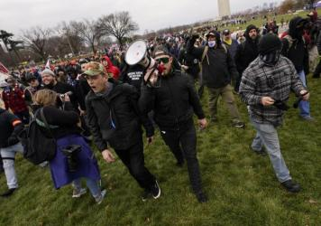 Ethan Nordean, with bullhorn, leads members of the far-right group Proud Boys before the riot at the U.S. Capitol on Jan. 6. The self-described sergeant-at-arms of the Seattle Proud Boys is facing federal charges over his role in the attack.
