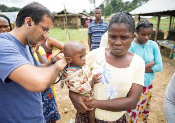 Dr. Raj Panjabi, the newly named head of the President's Malaria Initiative, treating patients during a visit to Liberia, where he was born and lived until 1990. He'll lead the effort to prevent and treat malaria around the world. Each year, some 400,000
