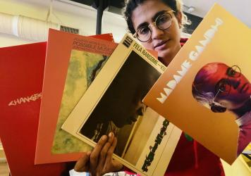 Madame Gandhi poses with her record collection.