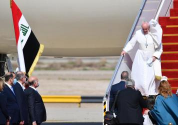 Pope Francis arrives at Baghdad International Airport on Friday for the first-ever papal visit to Iraq.