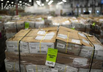 Pallets filled with Washington and Oregon mail-in ballots fill an unloading area at a U.S. Postal Service processing and distribution center on Oct. 14, 2020, in Portland, Ore.