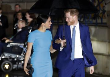"In a statement, Queen Elizabeth II said the royal family ""is saddened to learn the full extent"" of the challenges faced by Prince Harry and Meghan, the Duchess of Sussex, seen last March in London."