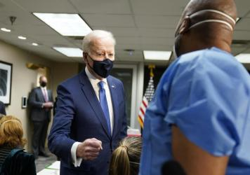 President Biden talks to recently vaccinated Army Staff Sgt. Marvin Cornish as he visits a COVID-19 vaccination site at the VA Medical Center in Washington, D.C., on Monday.