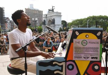 Jon Batiste performs at a voter registration event in Brooklyn, N.Y., in June 2020.