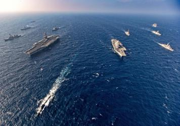 Aircraft carriers and warships participate in the second phase of Malabar naval exercise, a joint exercise by India, the U.S., Japan and Australia, in the northern Arabian Sea last November. The four countries form the Quadrilateral Security Dialogue, or