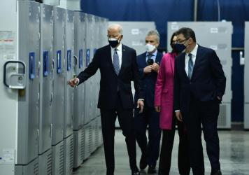 President Biden inspects COVID-19 vaccine freezers at a Pfizer plant in Kalamazoo, Mich., with White House Coronavirus Response Coordinator Jeffrey Zients, Michigan Gov. Gretchen Whitmer and Pfizer CEO Albert Bourla on Feb. 19.