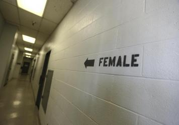 A sign points toward the women's section of the Huntington Beach jail. The National Council for Incarcerated and Formerly Incarcerated Women and Girls is appealing to President Biden to grant clemency to 100 women during his first 100 days in office.