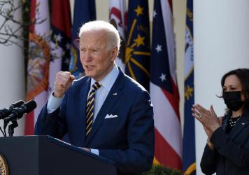 President Biden, with Vice President Kamala Harris behind him, speaks about the American Rescue Plan in the Rose Garden of the White House Friday.