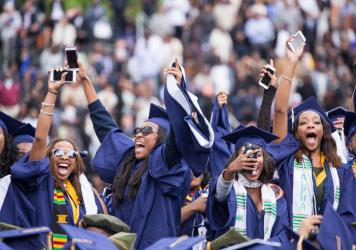 Students celebrate their graduation from Howard University at the end of the 148th Commencement ceremony, at the Upper Quandrangle on campus, on May 7, 2016. Washington, D.C. photojournalist and professor Cheriss May spoke about her photography on <em>Th