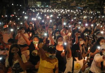 Protesters against last month's military coup hold a candlelight rally in Yangon, Myanmar, on  Saturday. More than 70 people have been killed by security forces since the military overthrew the country's fragile democracy six weeks ago, a United Nations