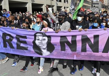 Tamika Palmer, center, the mother of Breonna Taylor, leads a march through the streets of downtown Louisville on the one year anniversary of Taylor's death on Saturday.